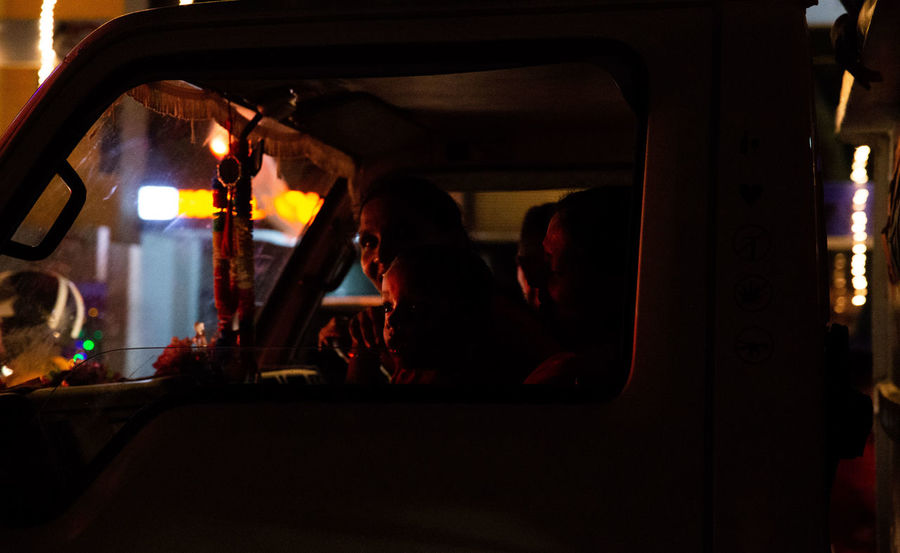 The streets were bustling and writhing with energy in Galle as Sri Lankans celebrated Vesak, the day of Buddah. Shooting from a Tuk Tuk in low light is extremely difficult in ever changing circumstances with light shifting every time traffic moves. Sri Lanka The Street Photographer - 2018 EyeEm Awards The Traveler - 2018 EyeEm Awards Car Interior Group Of People Land Vehicle Lifestyles Mode Of Transportation Motor Vehicle Real People Sitting Transportation Vehicle Interior Vesak