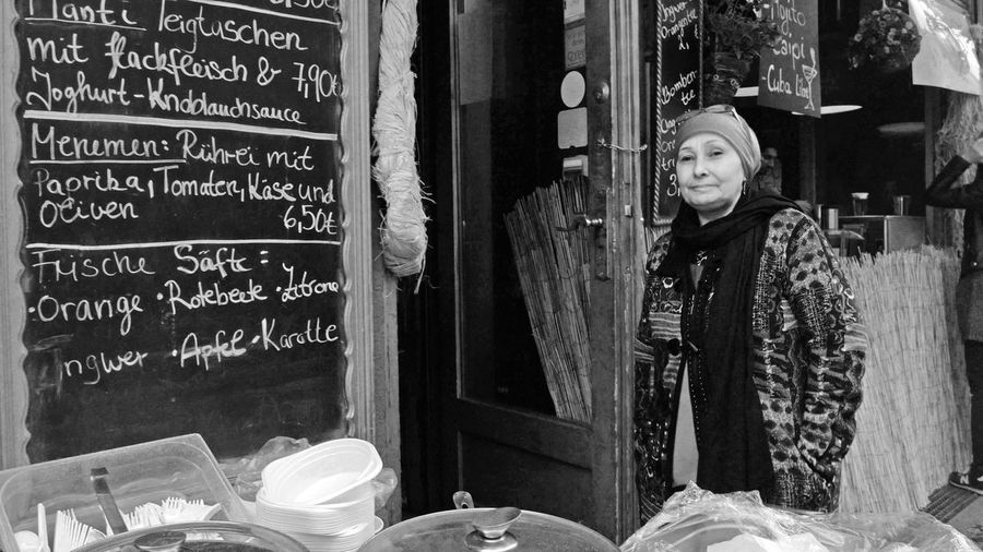 street food in kreuzberg Kreuzberg Menu Work Building Exterior Day Job Lifestyles Looking At Camera One Person Outdoors People Portrait Real People Smiling Standing Strassenfilm Street Food Warm Clothing Women
