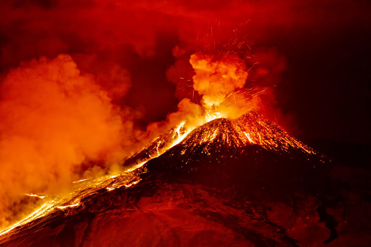 Scenic view of lava erupting from volcano