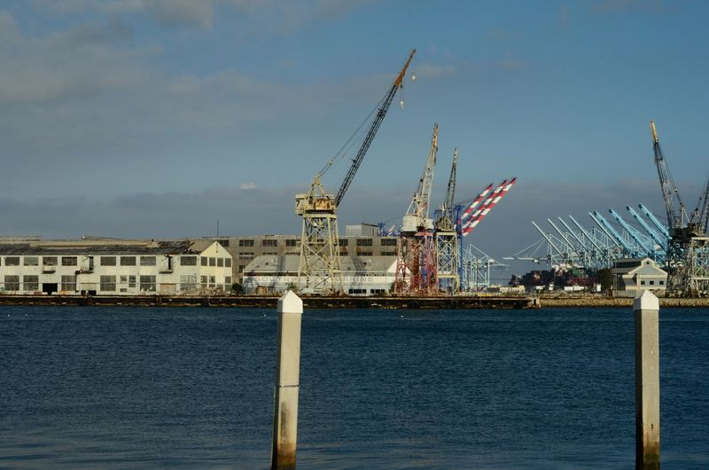 View of harbor against blue sky