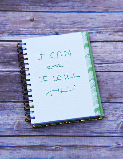 Motivational Quote in Notebook I Can And I Will MotivationalQuotes Close-up Communication Day High Angle View Indoors  No People Notebook Table Text Wood - Material