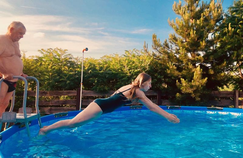 Just jump to swimmingpool Jump Moment Frozen Near Home Long Blond Hair Fun Vacations Travel Destinations Swimming Tanning ☀ Water Wasser Pool Swimming Pool Water Leisure Activity Lifestyles Women Fun Real People Nature Tree Child Adult Jumping Females Swimwear People Plant Outdoors My Best Travel Photo