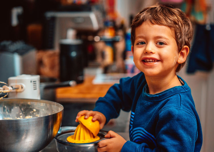 Smiling little boy squeezing out lemon for baking Holiday Bakery Baking Child Childhood Close-up Cute Day Domestic Kitchen Domestic Room Focus On Foreground Food Food And Drink Freshness Happiness Indoors  Kitchen Looking At Camera One Boy Only One Person People Portrait Real People Smiling Be. Ready.