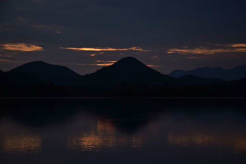 sunset in mountains Beauty In Nature Cloud - Sky Idyllic Lake Mountain Mountain Range Nature No People Non-urban Scene Outdoors Reflection Scenics - Nature Silhouette Sky Sunset Sunset In Mountains Tranquil Scene Tranquility Water Waterfront