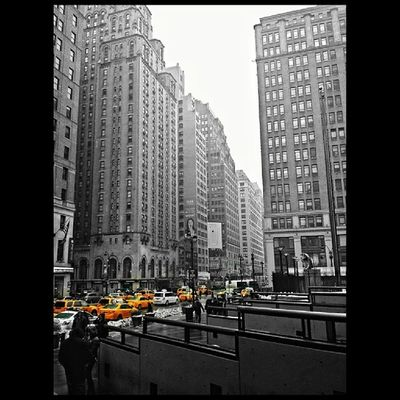 Gray Day ~ Just had to bring a little color to a gray day in NYC. Pennstation Newyorkcity NYC Manhattan nyc_explorers nycprimeshot people blackandwhite bnwphotography colorsplash interesting cool ILoveNY citylife instagood fartoodope taxifetish IG_NYCITY greatshotdude worldclassshots around_instagram rain cloudy nature streetphotography editallstarz