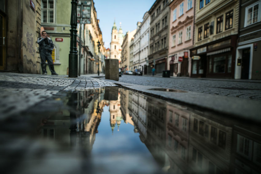 Charles Bridge Czech Republic Praha The Journey Is The Destination The Week on EyeEm Travel Architecture Building Exterior Built Structure Canonphotography City Day Europe Light And Shadow Outdoors Puddle Real People Reflection Sky Street Travel Destinations Water Waterfront