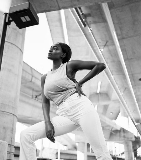 Concrete Echoes Black Woman Lifestyle Urban Lifestyle Woman Architecture Balance Beautiful Woman Day Exercising Flexibility Freeway Inspire Leisure Activity Lifestyles Low Angle View One Person Outdoors Real People Skill  Skin Sports Clothing Urban Life Woman Portrait Young Adult Young Women