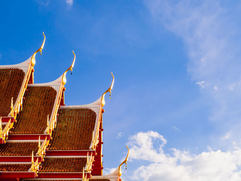 Close up of old thai temple roof in the morning with beautiful blue sky, copy space. Beautiful Cloud Gold Rooftop Architecture Art Blue Blue Sky Building Exterior Built Structure Cloud - Sky Day Gold Colored Low Angle View Nature No People Old Outdoors Pattern Religion Religious  Roof Sculpture Sky Temple