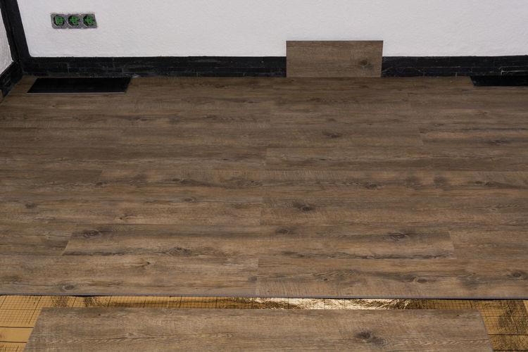 High angle view of bench on hardwood floor