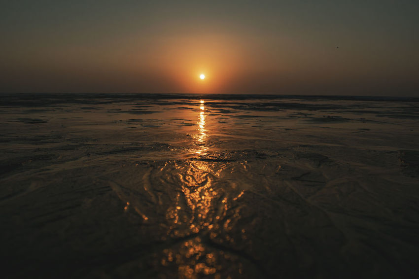 Beach Beauty In Nature Horizon Horizon Over Water Idyllic Land Nature No People Orange Color Outdoors Reflection Scenics - Nature Sea Sky Sun Sunset Surface Level Tranquil Scene Tranquility Water