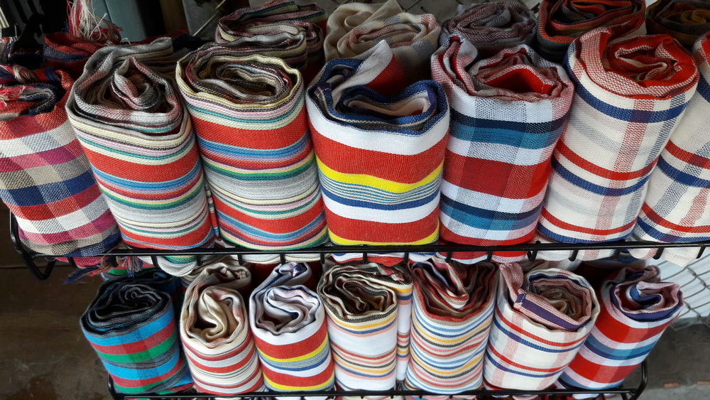 Colorful Fabrics At Store Store Shelf Market For Sale Colorful Top View Fabrics Traditional Cutting Large Group Of Objects Multi Colored Variation Stack Indoors