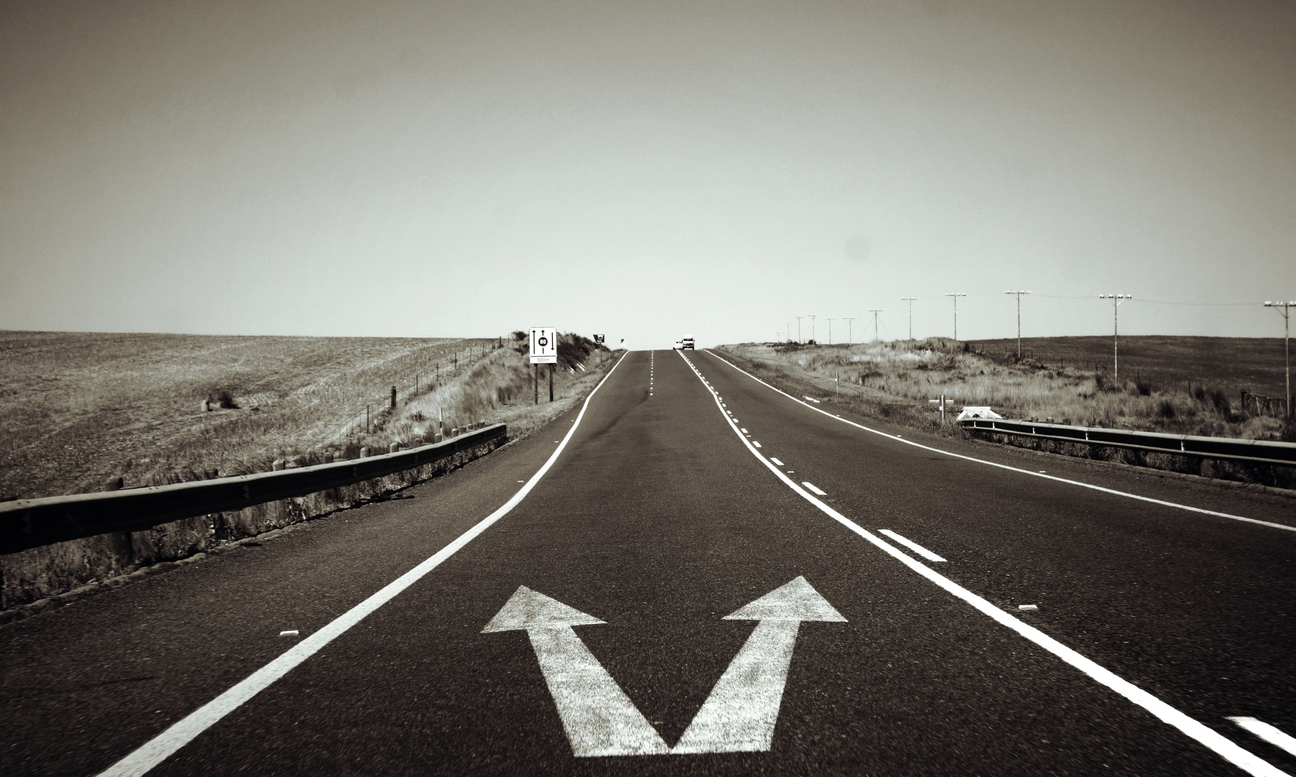 transportation, road marking, the way forward, road, diminishing perspective, vanishing point, asphalt, communication, direction, empty, text, clear sky, dividing line, guidance, empty road, copy space, road sign, arrow symbol, country road, street
