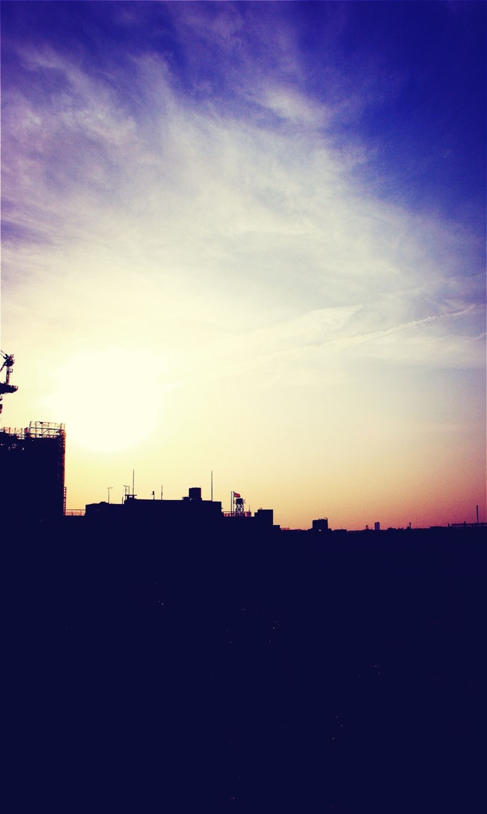sunset, silhouette, building exterior, built structure, architecture, sky, copy space, scenics, beauty in nature, orange color, blue, city, sunlight, dark, outline, nature, cloud - sky, sun, outdoors, cloud
