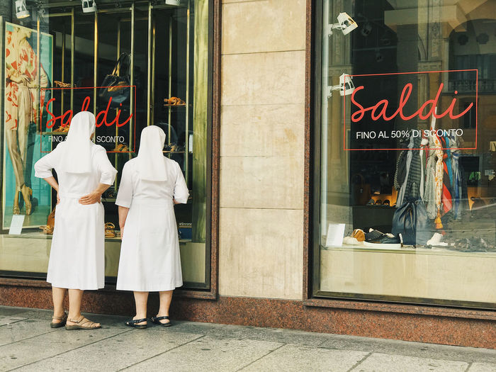 Thank God for sales Accessories Browsing Candid Day Discount EyeEm Best Shots High Street Interesting Perspectives Italy Milan Nuns Offer People Real People Rear View Sales Shoes Shop Store Storefront This Week On Eyeem Window Window Shopping Women Women Around The World