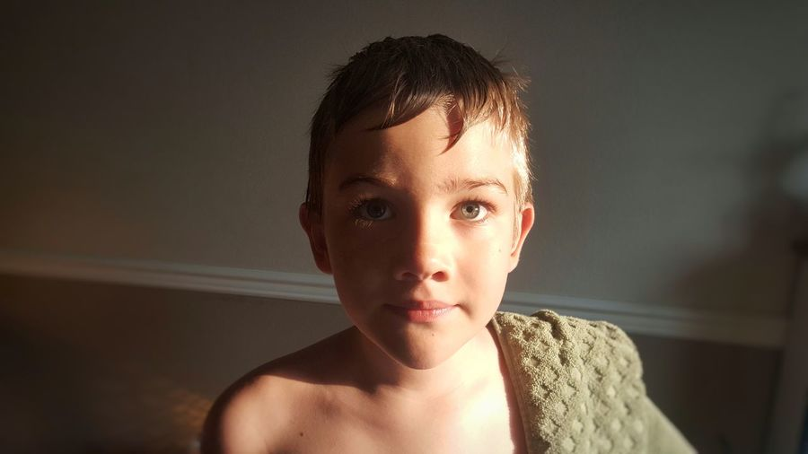 Portrait of shirtless boy at home