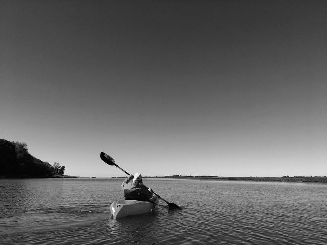 Kayaker in black and white Black & White Blackandwhite Kayak Kayaker Kayaking In Nature Kayaking Water Copy Space Clear Sky Nature Nautical Vessel Adventure Leisure Activity One Person Day Tranquility
