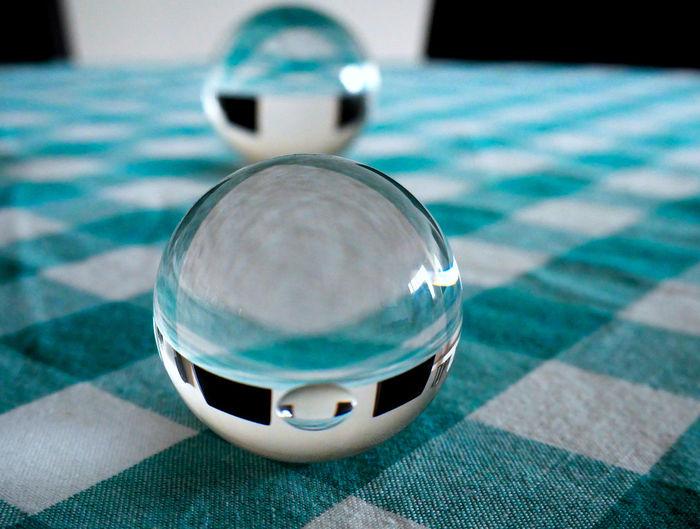 High angle view of crystal ball on table