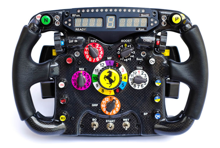 Formula One Steering Wheel Replica Product Photography Formula 1 Formula One Racing Ferrari Ferrari Wheel Technology Racing Motorsport Product Photography White Background Knobs And Dials Lcd Display Shifters Paddle Shifters Steering Wheel