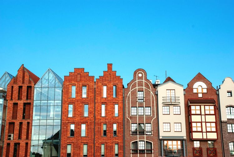 New Old Contrast Narrow Cityscape Hanseatic Hanseatic League Urban Gdansk Poland Danzig Architecture Built Structure Building Exterior Building Sky Blue City Clear Sky No People Day Residential District Window Row House Sunny Sunlight