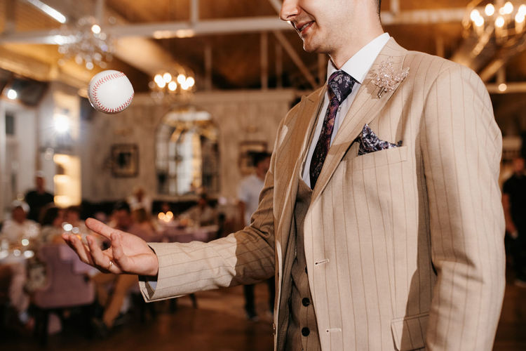Midsection of man holding in suit asking for dance