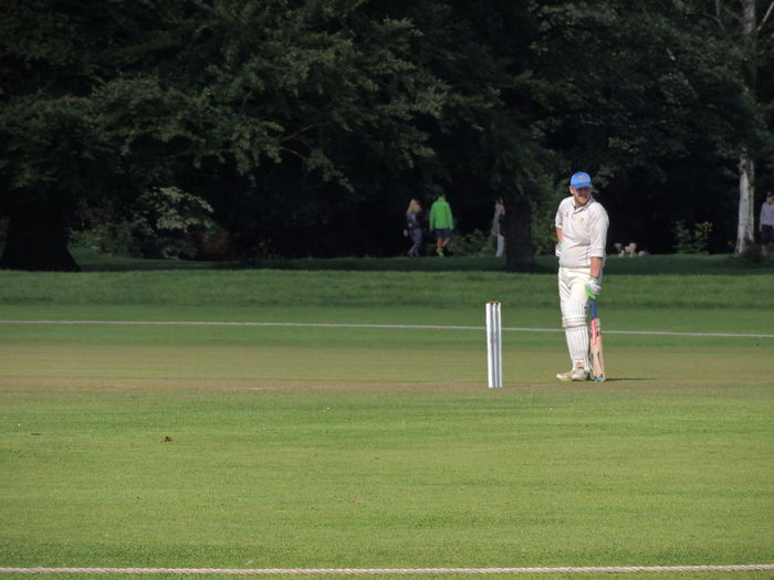 Cricket Field Cricket Cricket Match Day Full Length Golf Grass Green - Golf Course Green Color Growth Leisure Activity Lifestyles Men Nature Outdoors People Playing Real People Sport Standing Togetherness Tree Two People Cricket! Cricket Ball