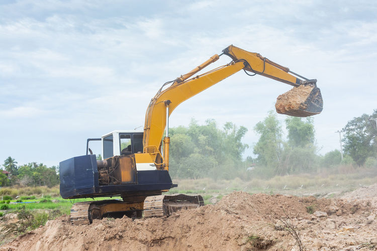 Yellow excavator machine working earth moving works at construction site Excavator Yellow Bucket Bulldozer Construction Digger Dirt Earth Excavating Hydraulic Loader Machine Movers
