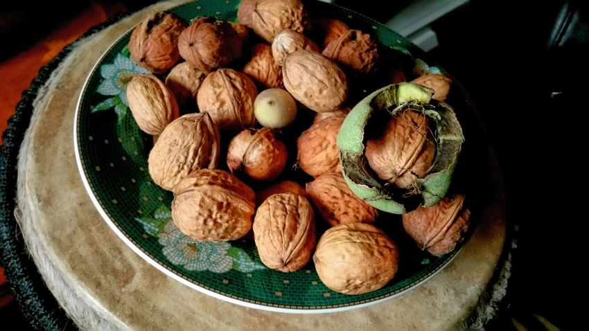 A Walnut hatching out if its skin. Pretty cool. My walnut baby. Ha! Brown Shell Many Nuts Food Healthy BP Healthy Eating Eat Wrinkled Texture Hatching Skin Covering Green Opening New Life Erupting Ripened Pattern Dish Drum Head Tan Close-up Food And Drink Nutshell Nut - Food Walnut Nut