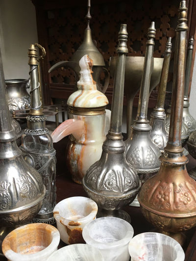 Assorted Turkish rose water bottles and carved marble jug and cups Beautiful EyeEmNewHere Jugs Assortment Bottles Brass Close-up Copper  Cups Decorative Decorative Bottles Dust Collector Indoors  Marble Metal Metal Bottles Miniature No People Pressed Metal Rosewater Table Traditional Turkish Urns Variation