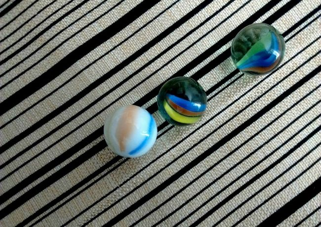 Canicas. Marbles Multi Colored High Angle View Pattern No People Close-up Day Indoors  Shadow Peacock Canicas Marbles ♡