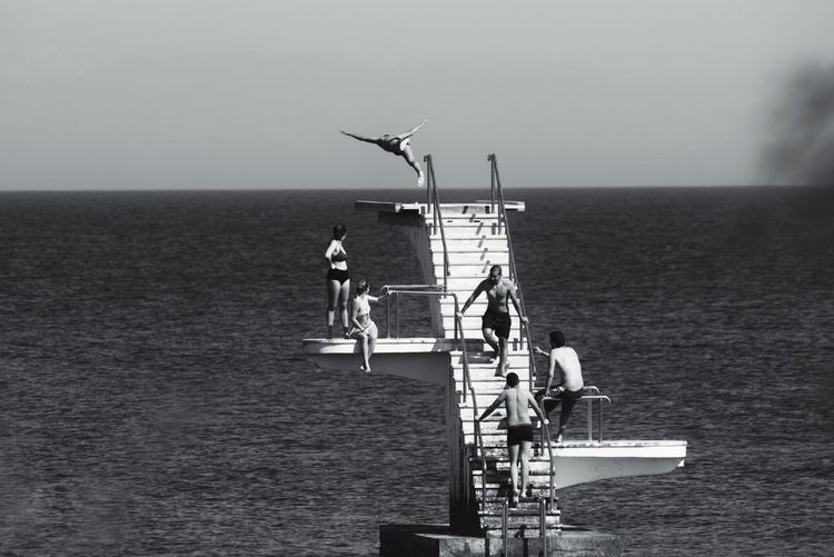 """""""Learning to fly..."""" Friends Friendship People Real People Blackandwhite B&w EyeEm Best Shots EyeEm Gallery Eye4photography  Real Life Summer Summertime Sea Sea And Sky Capture The Moment Capturing Freedom Diving Summer Views Sunny Day Island Islandlife Sea Occupation Togetherness Sky Horizon Over Water Diving Platform Freshwater"""