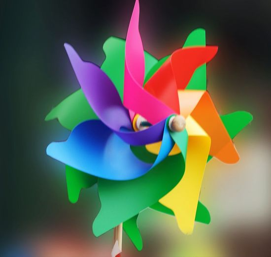 Paper propeller Multi Colored Art And Craft Craft Creativity No People Paper Close-up Plant Decoration Origami Focus On Foreground Ribbon - Sewing Item Toy Bow Representation Pinwheel Toy Studio Shot Indoors  Ribbon Flower