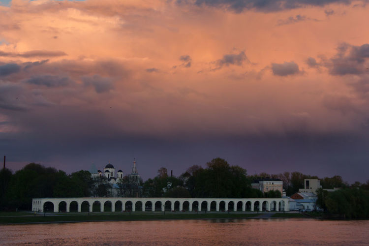 Architecture Beauty In Nature Bridge - Man Made Structure Building Exterior Built Structure Cloud - Sky Day Nature No People Outdoors River Scenics Sky Sunset Tree Water