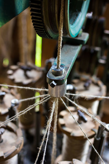Making ropes the old way. Close-up Craftsmanship  Cropped Detail Handmade Machine Part Making Rope Metal No People Old Part Of Rope Rope Ropemaker Selective Focus Spinning Technical Detail Technology Work Tool