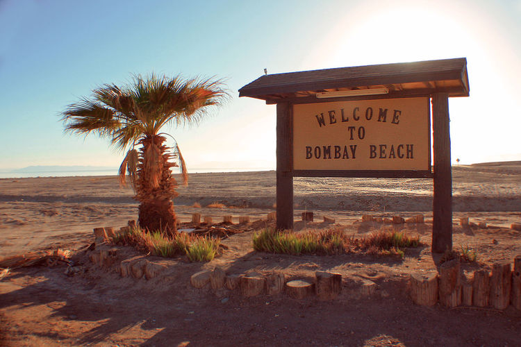 Bombay Beach Desert Salton Sea Day Desert Ghost Town Landscape No People Sand Suburban Decay Sunlight Text Welcome Sign
