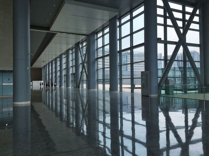 Columns reflecting on floor at china national convention center