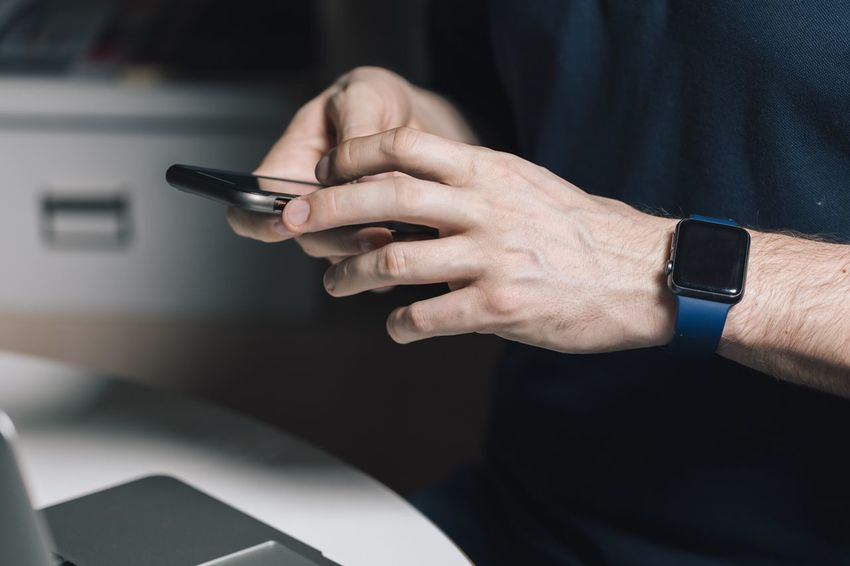 EyeEm Selects Hand Human Hand One Person Human Body Part Wristwatch Watch Time Focus On Foreground Real People Indoors  Men Adult Smart Watch Technology Finger Holding Communication