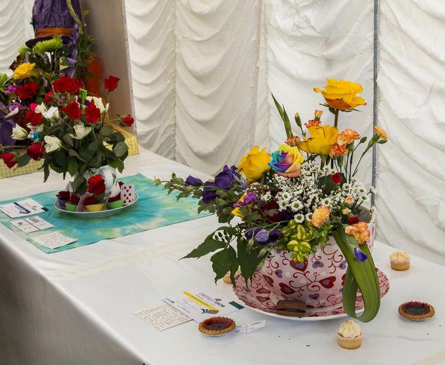 Bouquet Bride Celebration Close-up Day Flower Flower Arrangement Flower Head Fragility Freshness Groom Indoors  Life Events People Plate Table Vase