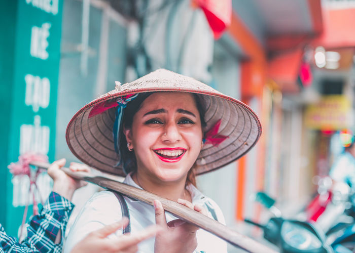 Happiness in Ha Noi! Beautiful Woman Building Exterior City Close-up Happiness Hat Headshot Holding Lifestyles Looking At Camera People Portrait Real People Smiling Young Adult Young Women An Eye For Travel Business Stories Love Yourself Press For Progress This Is My Skin The Portraitist - 2018 EyeEm Awards The Traveler - 2018 EyeEm Awards This Is Natural Beauty Moments Of Happiness #NotYourCliche Love Letter International Women's Day 2019