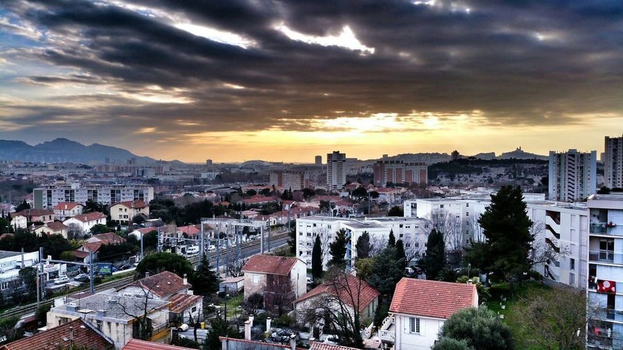 High angle view of cityscape against cloudy sky at les pennes-mirabeau