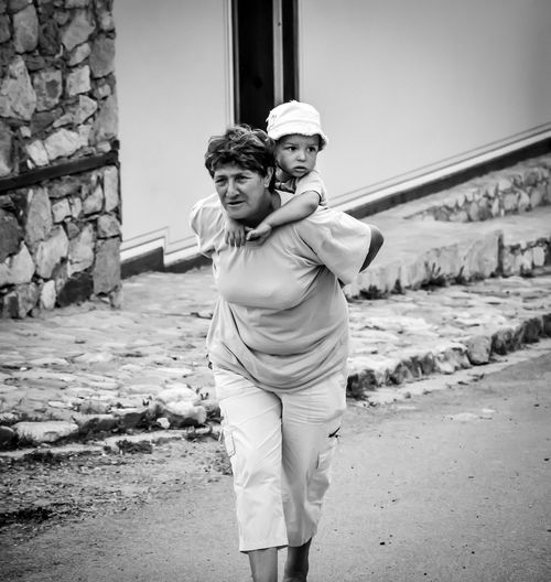 Baby Back Carrying Close Dear Grandma Heart Home Love Outdoors Relatives Walking The Photojournalist - 2016 EyeEm Awards Natural Light Portrait