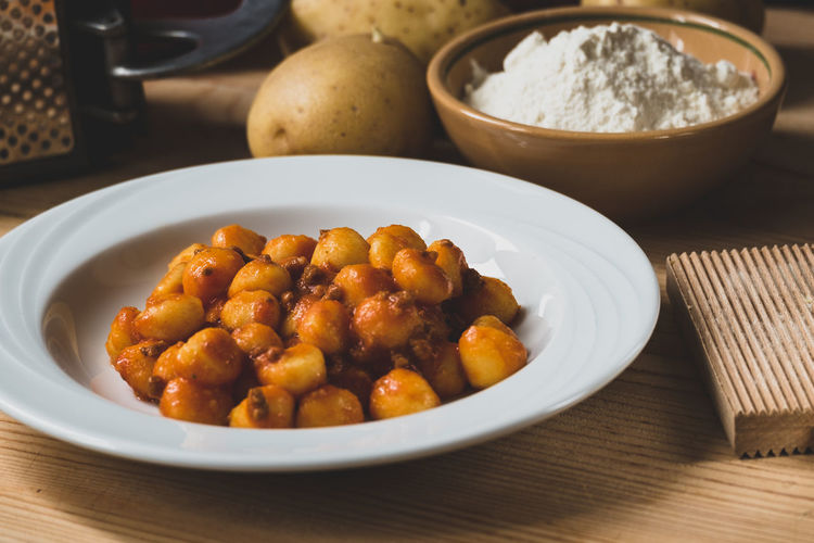 Gnocchi Gnocchi Di Patate Bowl Close-up Day Food Food And Drink Freshness Gnocchihomemade Healthy Eating Indoors  Italian Food No People Pasta Plate Potatoes Ready-to-eat Sauce Serving Size Table