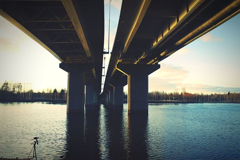 Bridge - Man Made Structure Connection River Architecture Built Structure Underneath Engineering Water Below Transportation Bridge Waterfront Outdoors City Architectural Column No People Sky Under Sunset Nature Finland Spring Time