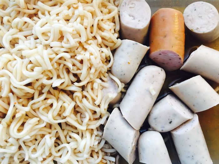 Close-up of noodles and sausages