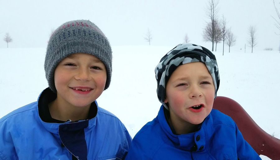 Winter Looking At Camera Two People Snow Boys Warm Clothing People Fun Happiness Friendship Close-up Brothers Two Boys Cheerful Bonding Smiling Happiness Togetherness Fun In Snow Winter Winter Playtime Boy In Snow Blue