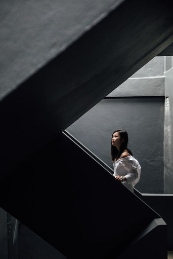 Woman standing on steps in building