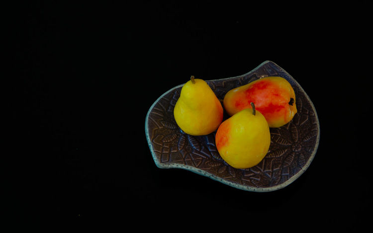 pear shaped soap in a soap dish Black Background Close-up Copy Space Cross Section Cut Out Food Food And Drink Freshness Fruit Healthy Eating Healthy Lifestyle High Angle View Indoors  No People Orange Orange Color Passion Fruit SLICE Soap Soap Dish Still Life Studio Shot Tropical Fruit Wellbeing
