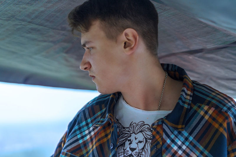 Close-Up Of Young Man Looking Away