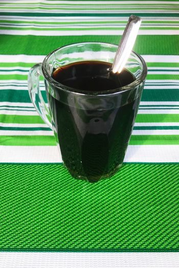 Morning coffee Green Color Food And Drink Drink Refreshment Cup Indoors  Table Eating Utensil Freshness No People Close-up Tea Household Equipment Mug Glass Food Still Life Wellbeing Hot Drink Spoon