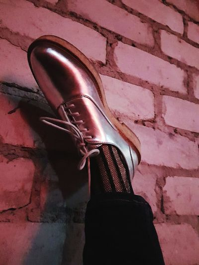 Resting feet Party Tired Foot Shoe Silver Shoes Fishnetstockings Brick Wall One Person Low Section Day Pink Color Shadow EyeEmNewHere Fashion Stories