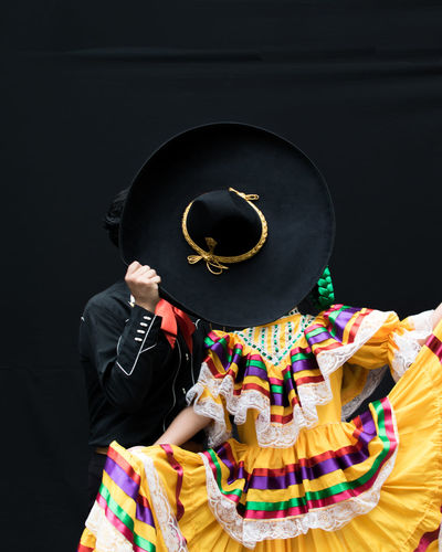 Dancers Performing Against Black Background